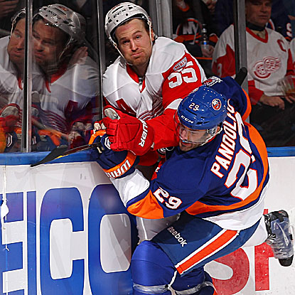 Jay Pandolfo (right) and the Islanders improve to 5-0-1 against the Red Wings since the lockout.  (Getty Images)