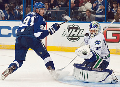 Cory Schneider turns away all three shots in the shootout, including the one by Steven Stamkos. (Getty Images)