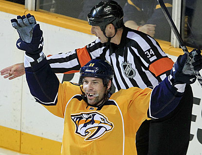 While the referee points to the net, David Legwand already knows he got the winner early in the overtime session. (AP)