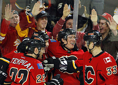 Playing in his third game in Calgary, Blair Jones (center) celebrates his timely goal with his teammates. (AP)