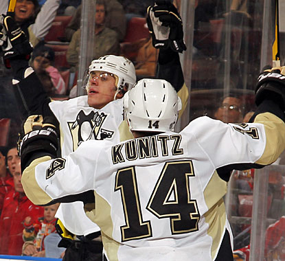 Evgeni Malkin celebrates his late second-period goal with linemate Chris Kunitz. (Getty Images)