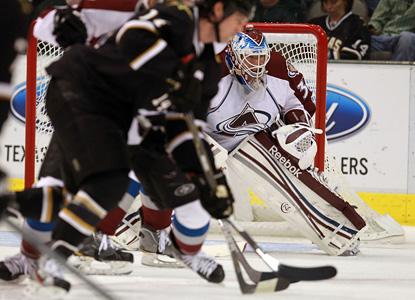 The Avs' Jean-Sebastien Giguere sends back 21 shots to help Colorado improve to 50 points on the season. (Getty Images)