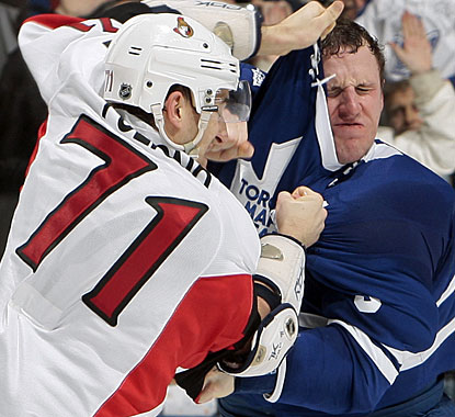 Toronto captain Dion Phaneuf (right) fights Nick Foligno after taking a low hit from the Ottawa player. (Getty Images)