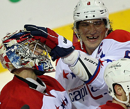 Alex Ovechkin (right) acknowledges goalie Michal Neuvirth, who stops 31 shots for his second shutout this season.  (AP)
