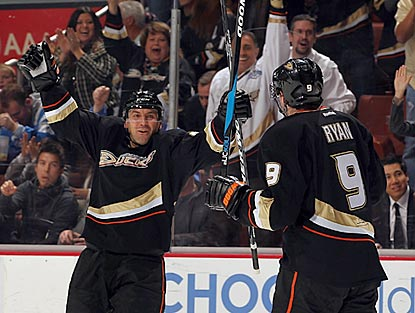Francois Beauchemin (left) celebrates a first-period goal with Bobby Ryan. The goal gives Anaheim a 2-1 lead.  (Getty Images)