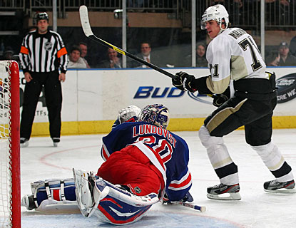 Evgeni Malkin takes advantage of a turnover to beat Henrik Lundqvist. Malkin later adds an empty-netter as well. (Getty Images)