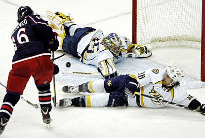 Pekka Rinne is able to stop this scoring chance by Derick Brassard before finishing with 38 saves. (AP)