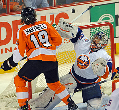 New York goalie Evgeni Nabokov (right) makes one of his 40 saves against Philadelphia during the Islanders' 4-1 win. (US Presswire)