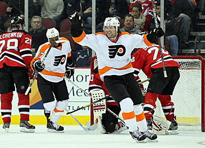 Philadelphia's Scott Hartnell (right) celebrates the first of his two goals against the Devils. (US Presswire)