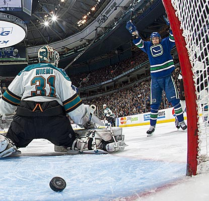 The Canucks' David Booth adds an assist to go with this deflected goal, his sixth of the season.  (Getty Images)