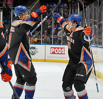 The Islanders' John Tavares (right) celebrates his game-winning goal in overtime. (Getty Images)