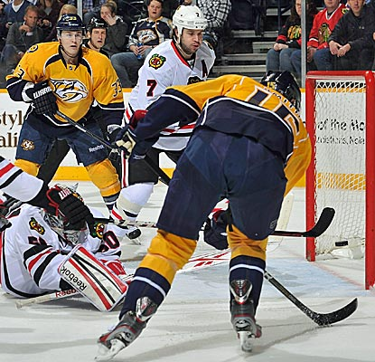 Craig Smith angles one of Nashville's five goals past Chicago goaltender Corey Crawford.  (Getty Images)