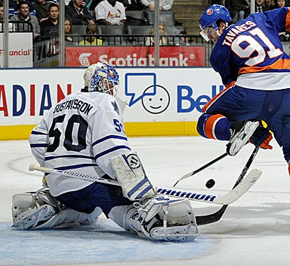 Goalie Jonas Gustavsson and the Leafs' D stop John Tavares' 12-game point streak.  (Getty Images)