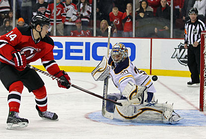 Ryan Miller turns away Adam Henrique's shootout try to help Buffalo win its first game on the road since Dec. 3. (US Presswire)