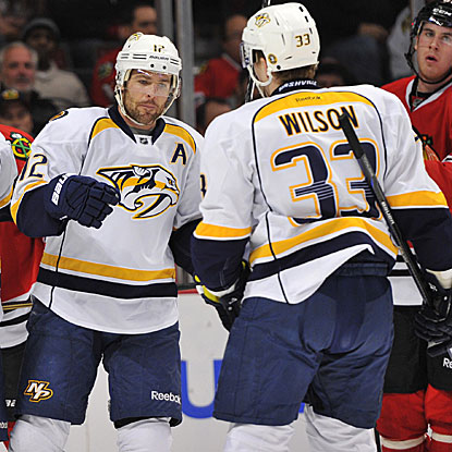 Mike Fisher (left) and Colin Wilson score two of the Predators' three goals in their victory over the Blackhawks.  (US Presswire)