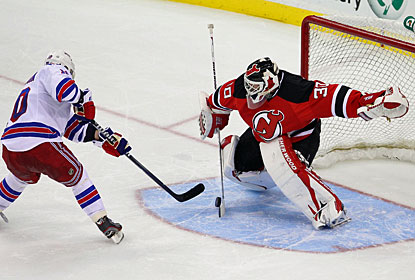 Martin Brodeur denies the Rangers' last chance in the shootout by stopping NHL All-Star MVP Marian Gaborik. (US Presswire)