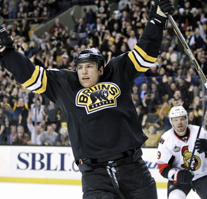 Milan Lucic finds the back of the net with 45 seconds left in the second period for the victorious Bruins.  (AP)