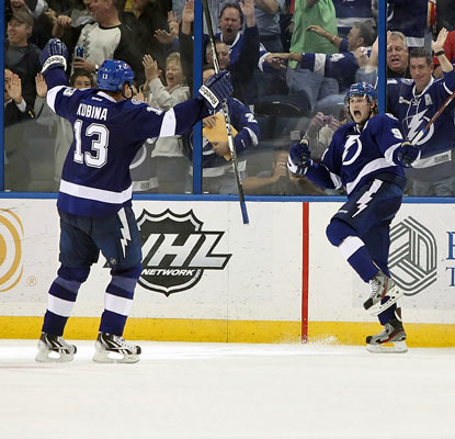 Steven Stamkos (left) celebrates his NHL-leading 33rd goal, which comes with 2:45 left in overtime to lift the Lightning.  (US Presswire)