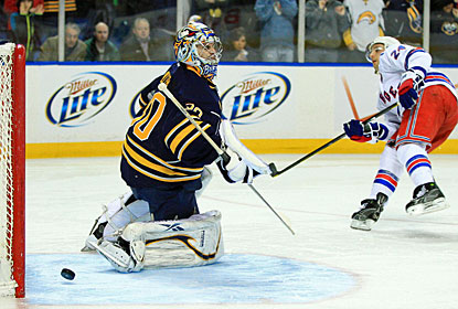 Ryan Callahan slides the puck past Ryan Miller for the only goal that counts on the scoreboard. (US Presswire)