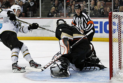 Jamie Benn, who missed five games due to an appendectomy, scores past Jonas Hiller. (AP)