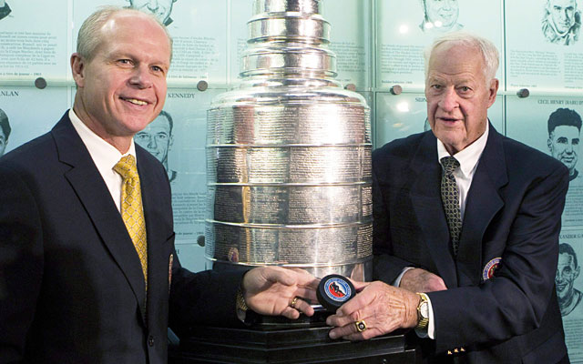 Mark Howe poses with dad Gordie and the Stanley Cup after his Hall of Fame induction in November. (AP)