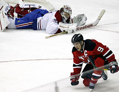 A beaten Carey Price watches Zach Parise enjoy his third-period goal, his second in the game. (AP)