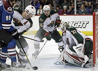 Minnesota goalie Niklas Backstrom stops 37 shots to record his third shutout of the season.  (AP)