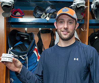Sam Gagner shows off the souvenirs he earned from registering eight points in a span of 34 minutes.  (Getty Images)