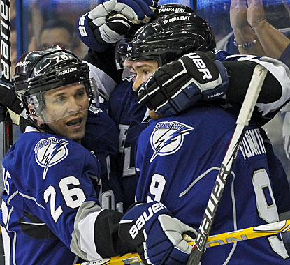 It's a good all-around day for Martin St. Louis (26), who records his fifth career hat trick -- first since 2006. (AP)