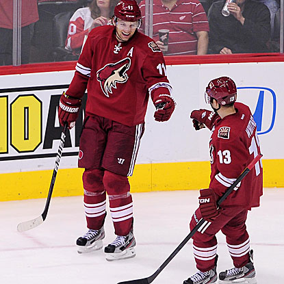 The Coyotes' Ray Whitney (13) congratulates teammate Martin Hanzal on scoring an empty net goal. (US Presswire)