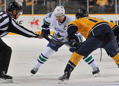 Henrik Sedin faces off here against the Preds' Nick Spaling.  Sedin contributes two assists in the shootout win. (Getty Images)
