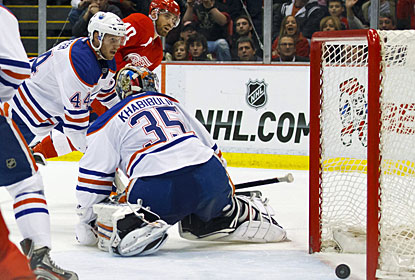 Edmonton's Corey Potter and Nikolai Khabibulin react late as Henrik Zetterberg's shot trickles in the net. (US Presswire)