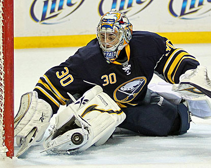 Ryan Miller makes a stop with his skate for one of his 36 saves in the shutout. (US Presswire)
