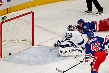 Brad Richards nets the winner after lunging for the puck and pushing it in the net while down on the ice. (US Presswire)