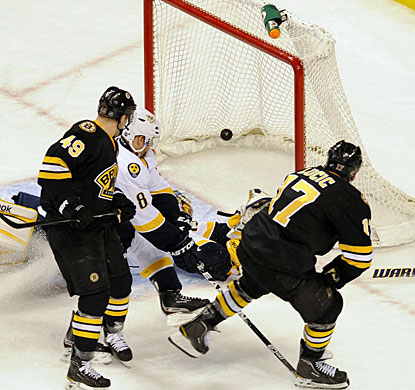 With only 67 seconds to play in regulation, Milan Lucic (17) finds the back of the net to tie the game at 3-3. (US Presswire)
