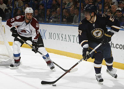 David Perron's pair of goals and assist helps set up the Blues to topple the Avs in overtime. (Getty Images)