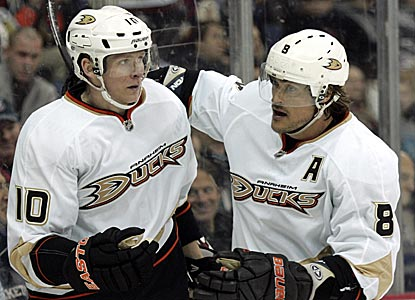 Anaheim's Corey Perry (left) helps keep the Ducks' slim playoff hopes alive with a hat trick.  (AP)