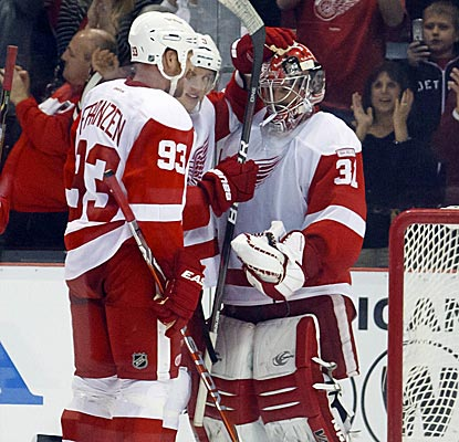 Red Wings goalie Joey MacDonald is congratulated after he holds tight against the Flyers' last push.  (US Presswire)