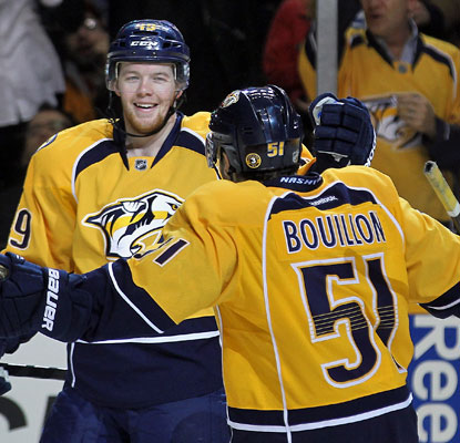 Nashville's Ryan Ellis celebrates the game-winning goal against Chicago with teammate Francis Bouillon. (Getty Images)