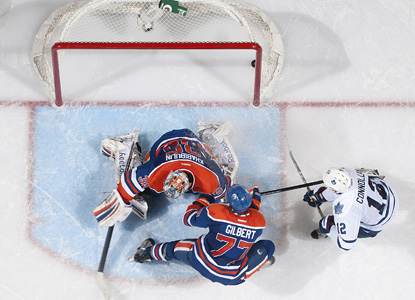Tim Connolly (right) scores in overtime to give the Maple Leafs the win over the Oilers. (Getty Images)