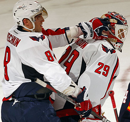 Alex Ovechkin, who scores Washington's first goal, celebrates with goaltender Tomas Vokoun. (Getty Images)