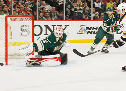 Wild's goalie Niklas Backstrom is massive behind net, sending back 48 to complete his fourth shutout of the year. (Getty Images)