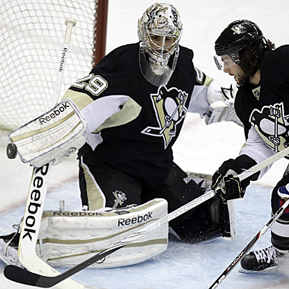 The Penguins' Marc-Andre Fleury collects the shutout and ties Tom Barrasso's franchise record with 22. (AP)