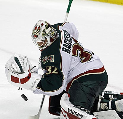 Niklas Backstrom stops 41 shots as the Wild earn just their second win in their last nine games.  (AP)