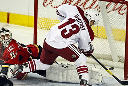The Coyotes' Ray Whitney scores the tying goal, then also scores the winning goal in a shootout victory over the Flames. (AP)
