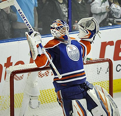 Oilers goalie Devan Dubnyk celebrates his shutout over the Flyers, Edmonton's second consecutive victory.  (AP)