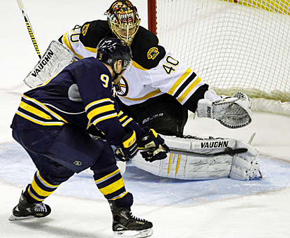 The Sabres' Derek Roy slips the game-winning goal past the Bruins' Tuukka Rask in the shootout. (AP)