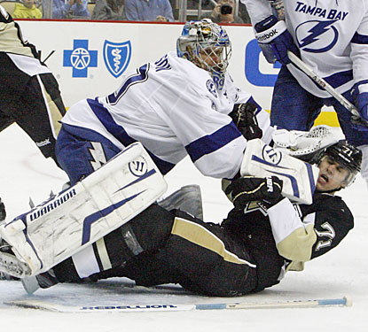 After taking a trapper to the face, Evgeni Malkin records his third hat trick of the season, No. 2 vs. the Bolts.  (US Presswire)
