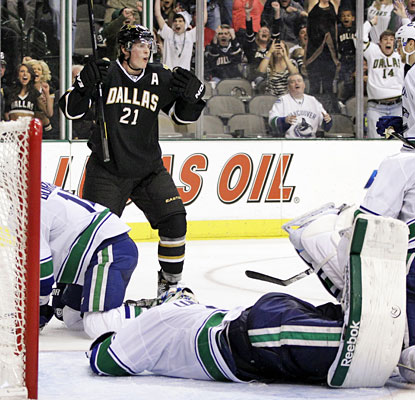 Loui Eriksson celebrates after putting the puck past Roberto Luongo to give the Stars the overtime victory.  (AP)