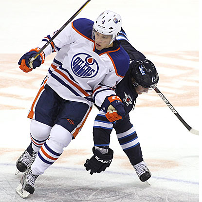 Taylor Hall scores one of the Oilers' four third-period goals in their win against the Jets.  (Getty Images)